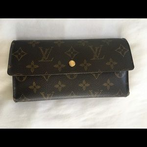 Louis Vuitton monogrammmed trifold wallet